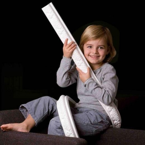 Child with flexible dado rail section